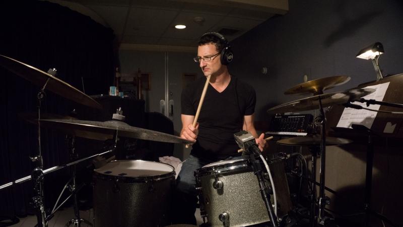 David Whitman at a drum set