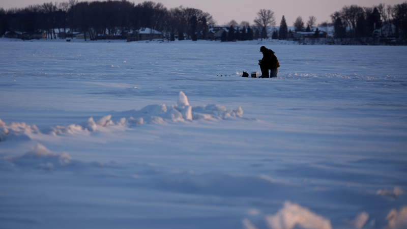 An ice fisherman fishes on Storm Lake in Storm Lake, Iowa
