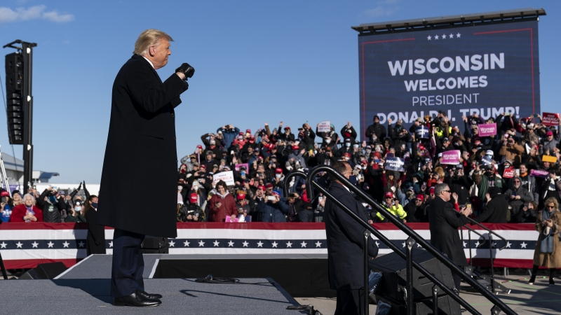 President Donald Trump arrives to speak at a campaign rally at Green Bay Austin Straubel International Airport, Friday, Oct. 30, 2020.