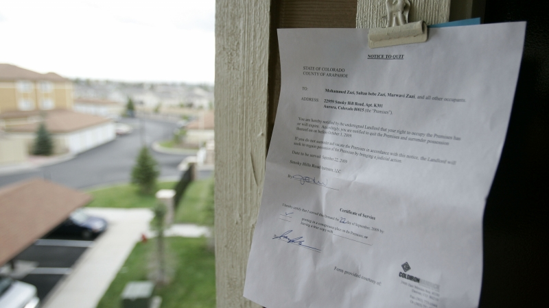 An eviction notice is posted on an apartment