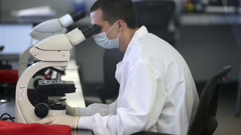 forensic scientist at crime lab