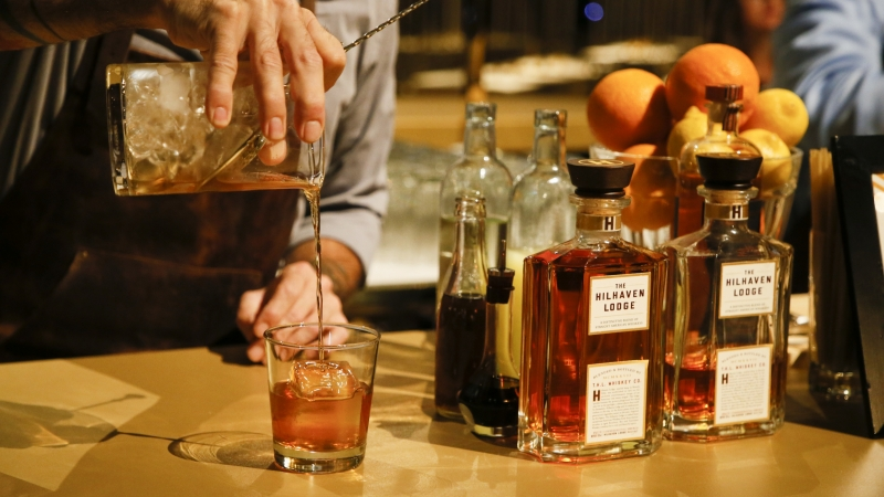 Bartender Charles Joly makes a cocktail