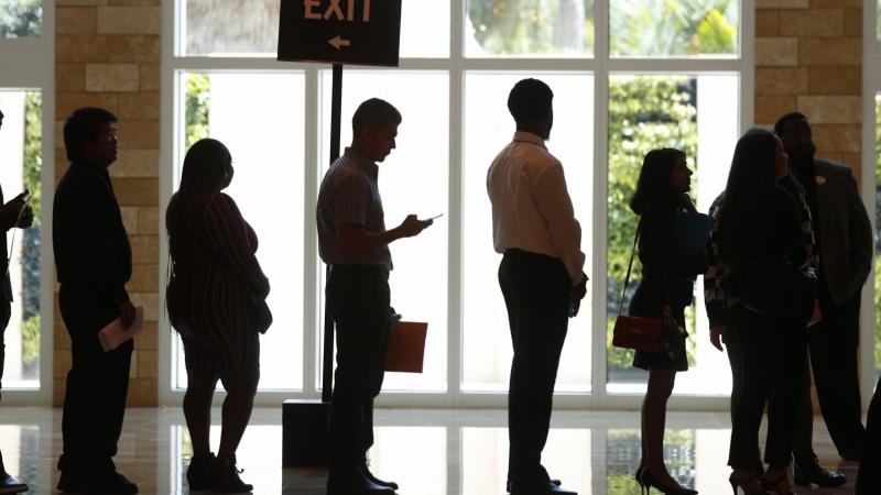 Job seekers in line at job fair
