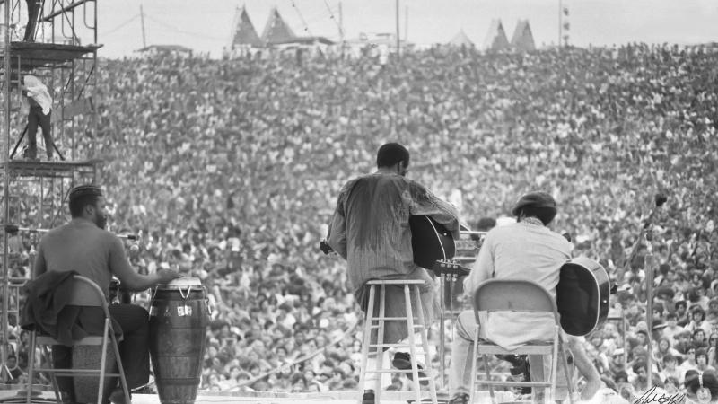 This August, 1969 photo shows Richie Havens as he performs during Woodstock