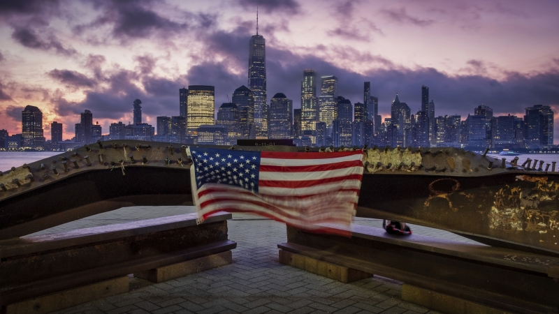 A U.S. flag hanging from a steel girder, damaged in the Sept. 11, 2001 attacks on the World Trade Center