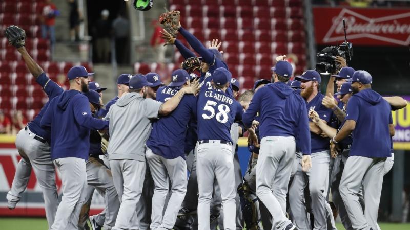 Milwaukee Brewers celebrate a 9-2 win over the Cincinnati Reds
