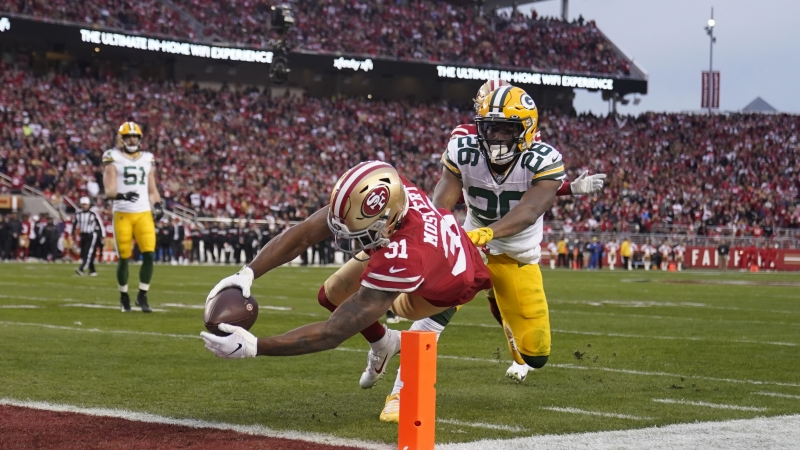 The San Francisco 49ers score on the Green Bay Packers