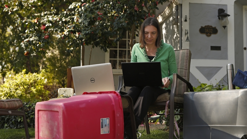 Alison Steffensen works at the home office she set up in the front yard of her home