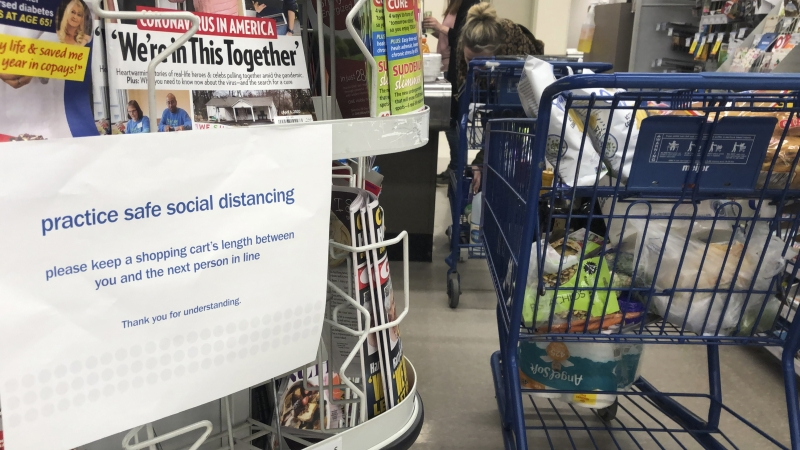 Grocery store sign alerts shoppers to practice social distancing