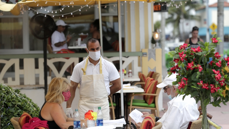 People sit outside at a restaurant during the coronavirus pandemic
