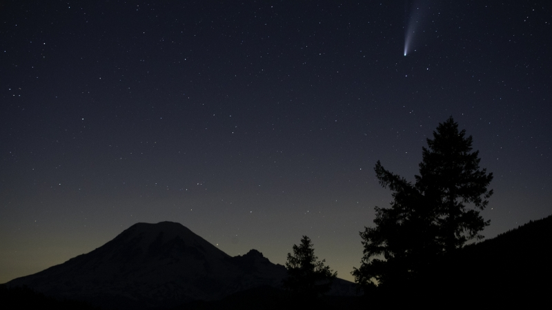 The Comet Neowise appears in the night sky above Mount Rainier, Saturday, July 18, 2020, near Packwood, Wash