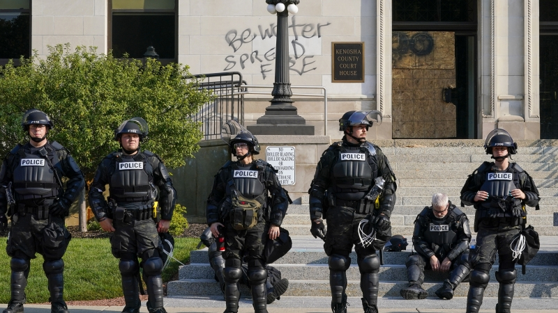 Kenosha Police in the city's downtown, following a night of protest on Aug. 23.