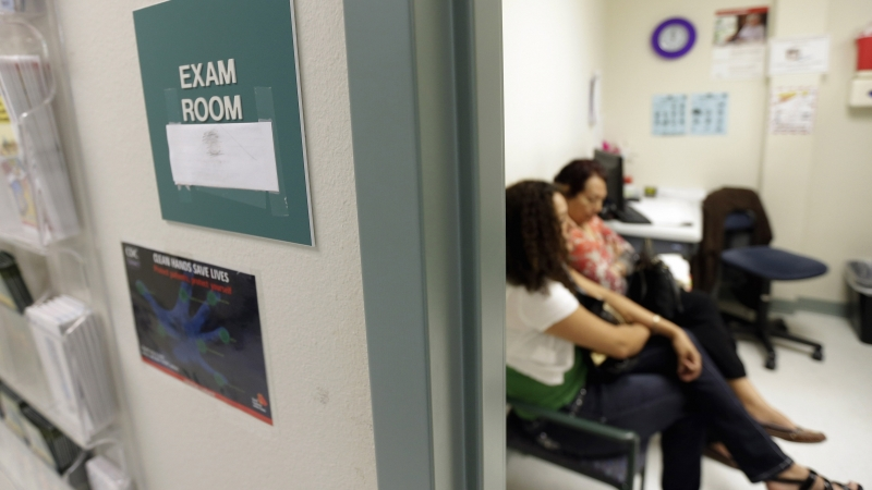 two women wait in an exam room at a doctor's office