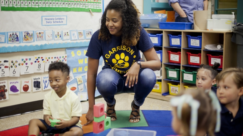 Epernay Kyles, center, Pre-K teacher at Garrison Elementary in the Logan Circle neighborhood in Washington, meets with her students on the first day of classes