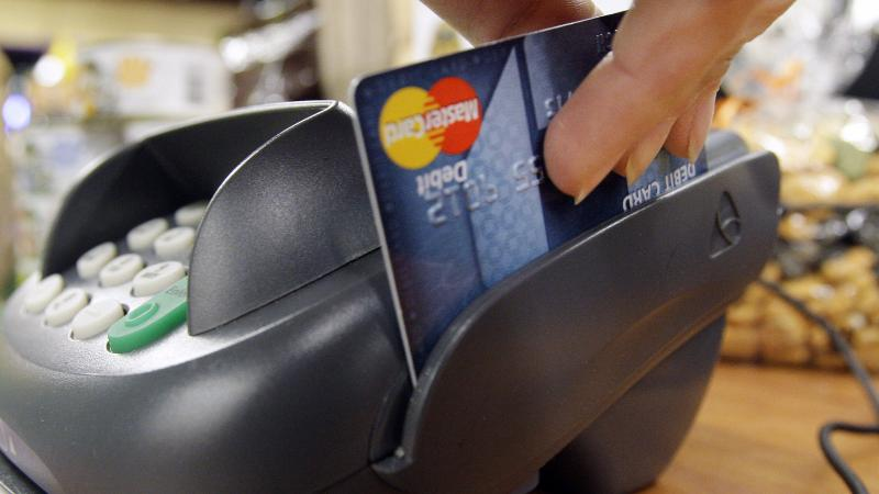 A debit card being swiped