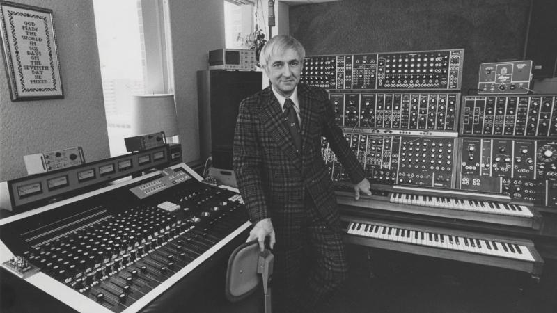 Don Voegeli stands in front of mixers.