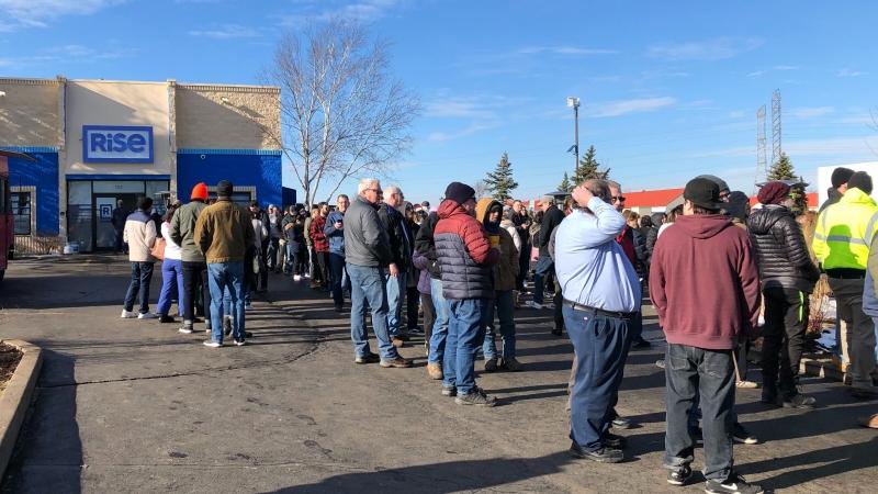 People in line outside a marijuana shop