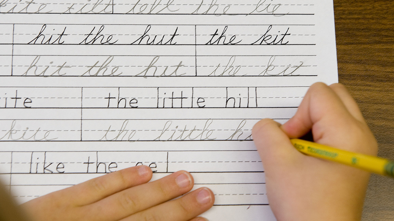 Child writing in cursive