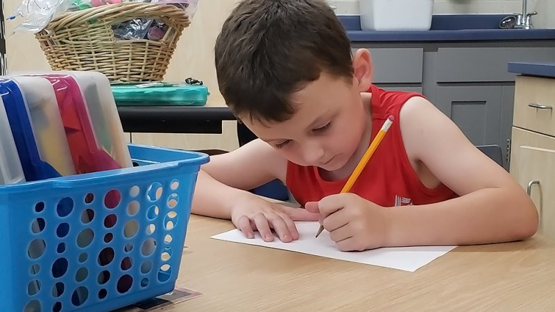 Declan Brommerich, 6, draws in his first-grade classroom at Trempealeau Elementary School.