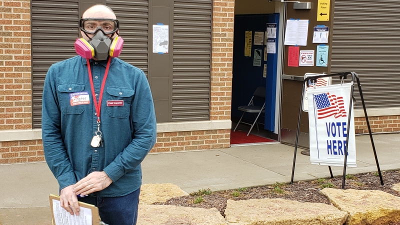 A poll worker in Madison works the polls amid the COVID-19 pandemic