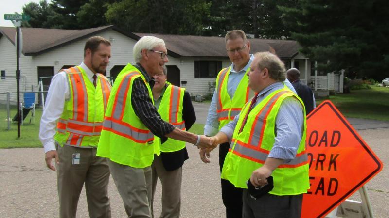 Gov. Tony Evers greets Wausau Mayor Robert Mielke