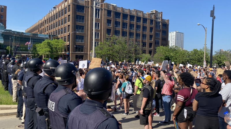 Demonstrators are met by Milwaukee Police after arriving atMilwaukee's Police Department headquarters