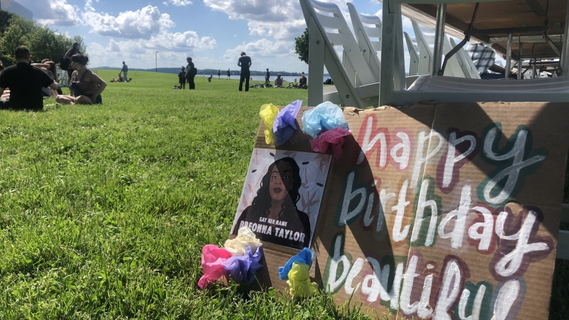 A sign reading Happy Birthday Beautiful for Breonna Taylor