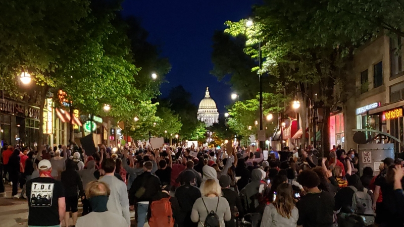 A few hundred protesters returned to State Street in downtown Madison on Sunday night, defying a curfew imposed by the city's mayor.