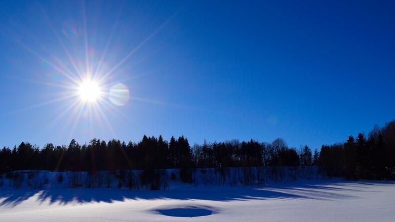 Sun rising over snow