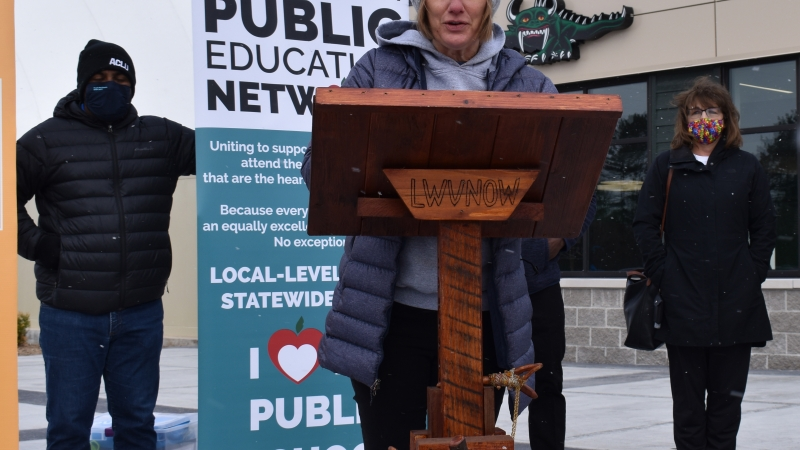 Heather DuBois Bourenane, executive director of the Wisconsin Public Education Network, speaks at a press conference outside the Joint Finance Committee's budget hearing in Rhinelander
