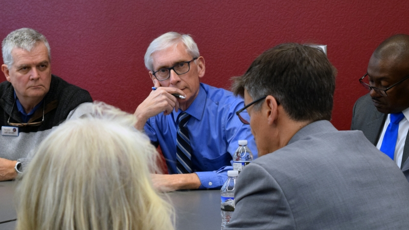 Tony Evers at flooding event