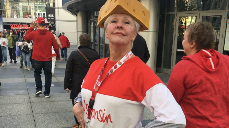 Badgers fan poses with cheesehead outside pep rally