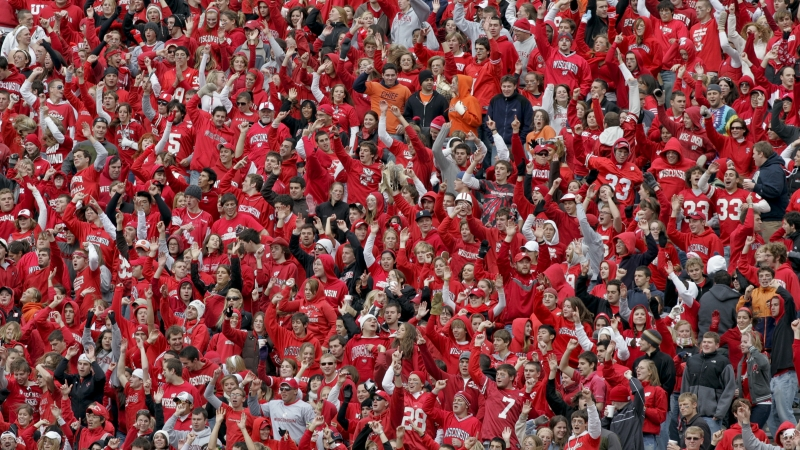 """Fans during """"Jump Around"""" at a Wisconsin Badgers football game."""