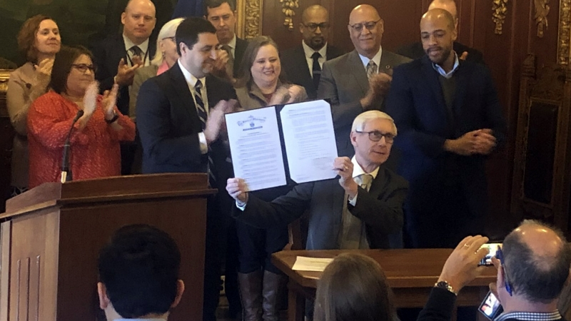 Tony Evers signs an executive order