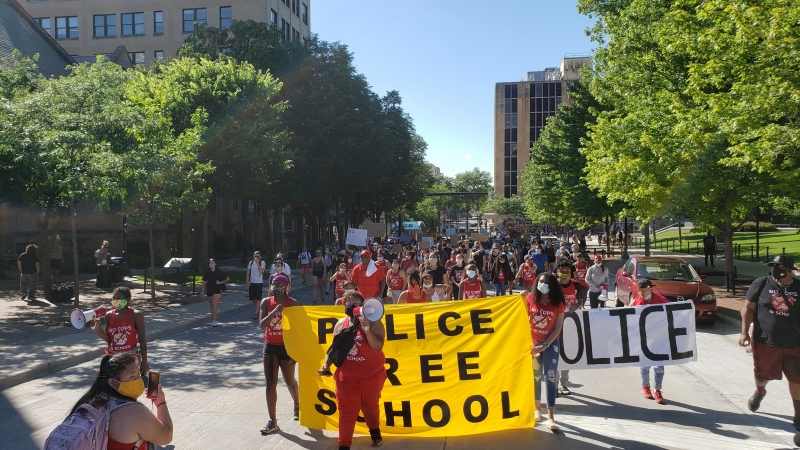 Activists march with Police Free Schools banner
