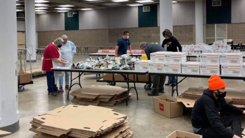 Volunteers pack up food that is being delivered to families for the Thanksgiving holiday.