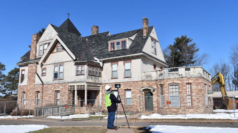 William Krueger of the University of Wisconsin-Milwaukee takes a digital laser-scan of the T.B. Scott Mansion in Merrill.