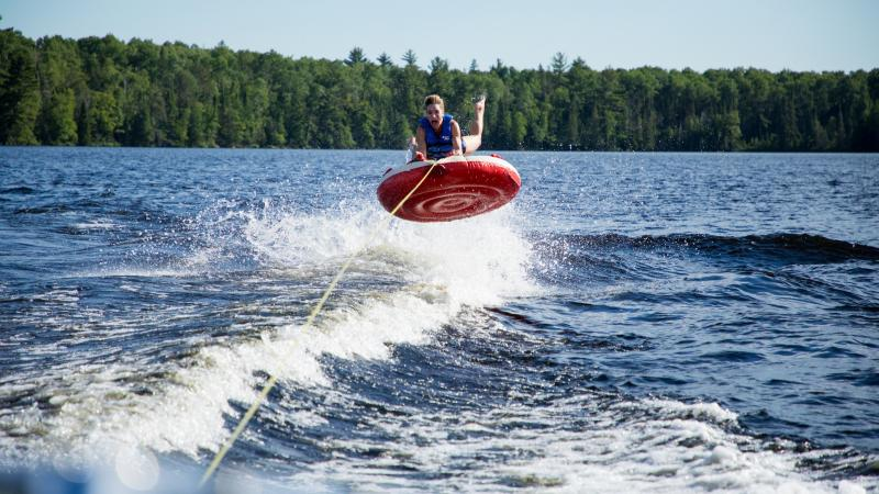 person tubing on a lake