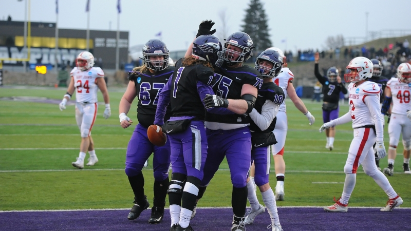 University of Wisconsin-Whitewater football players celebrate in the end zone