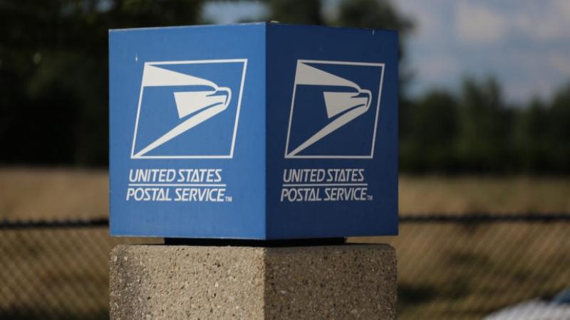 A U.S. Postal Service sign