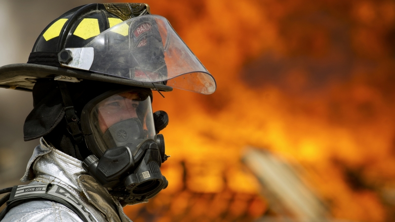 Firefighter in front of a fire