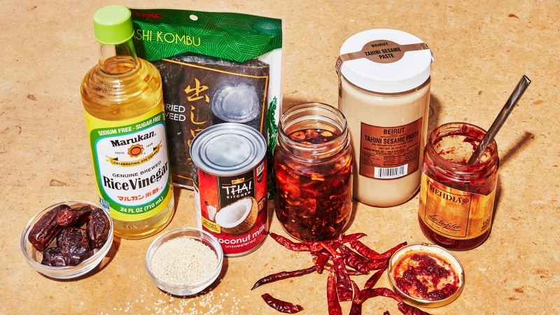 A few pantry ingredients and condiments sit on the counter.