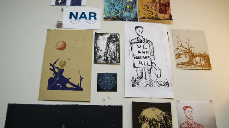collection of student lithographs on a wall
