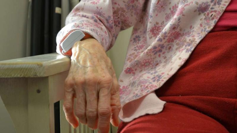 Woman resting wrist on bar