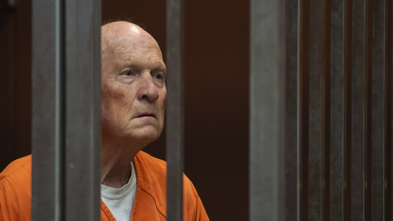 Former police officer Joseph DeAngelo, accused of being the Golden State Killer, stands in a Sacramento, Calif., jail court as a judge weighs how much information to release about his arrest