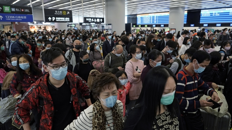 Crowd of people wearing face masks