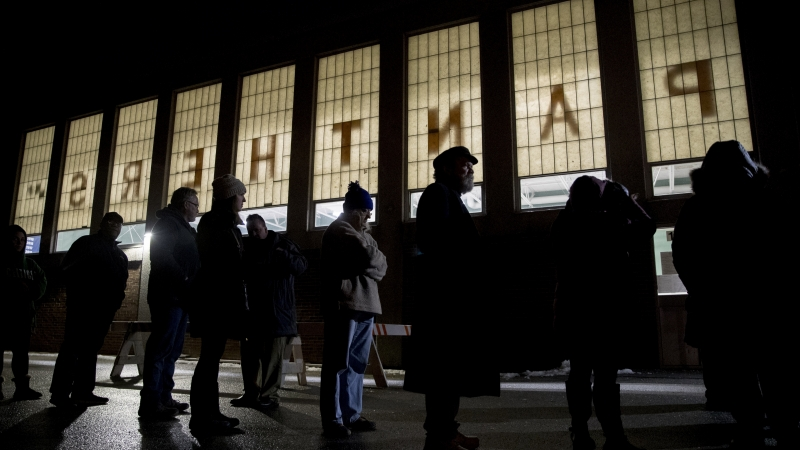 Voters wait for polling location to open in Manchester, N.H.