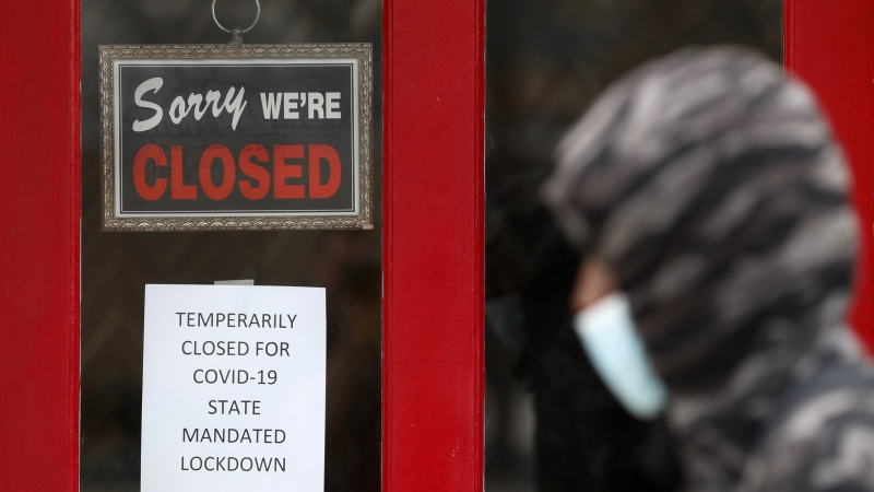 'Sorry We're Closed' sign hangs on business
