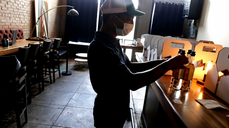 A man works in a restaurant during the COVID-19 pandemic