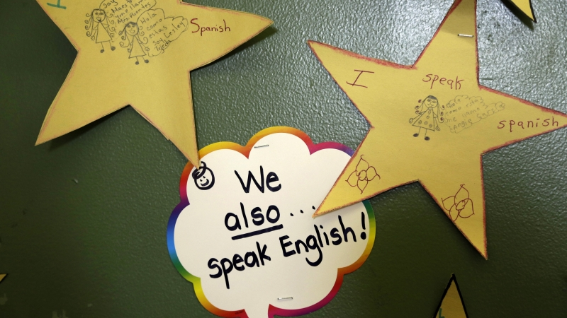 Signs outside of a classroom that speaks Spanish and English
